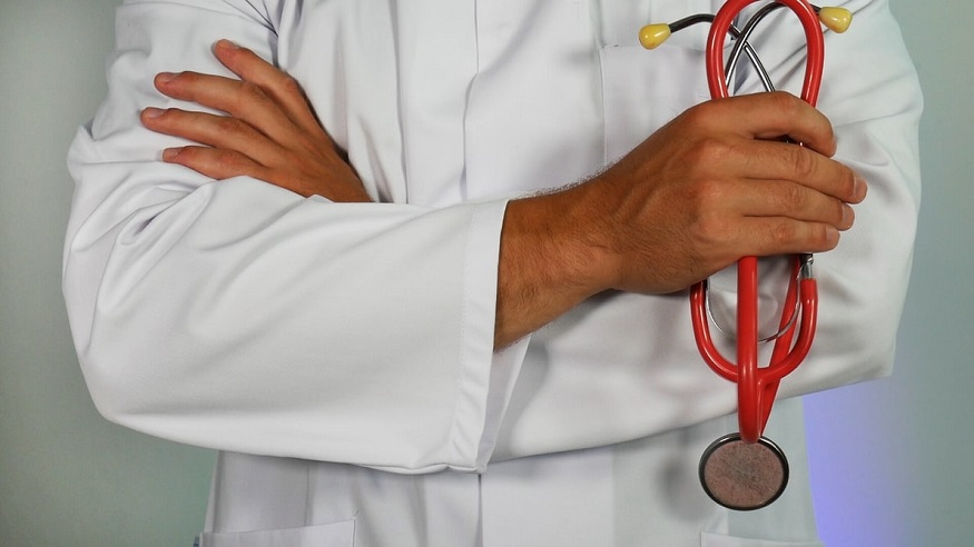 Public health insurance - doctor with stethoscope