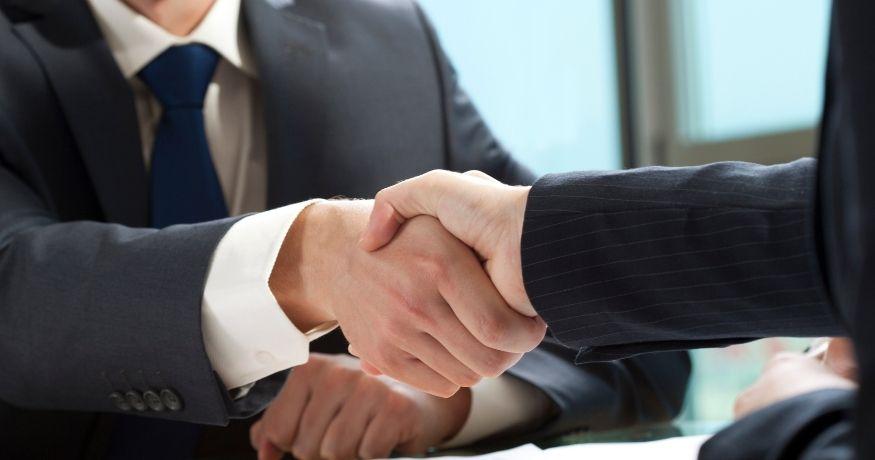 AIG Insurance - Business deal -handshake
