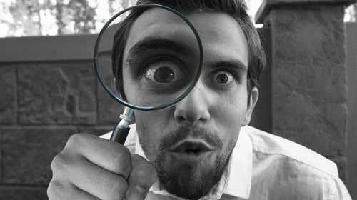 DIY home inspections - person using magnifying glass