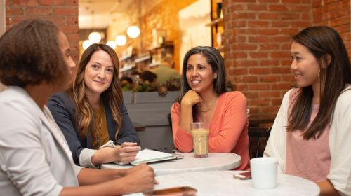 Employment practices liability insurance - women sitting around a table