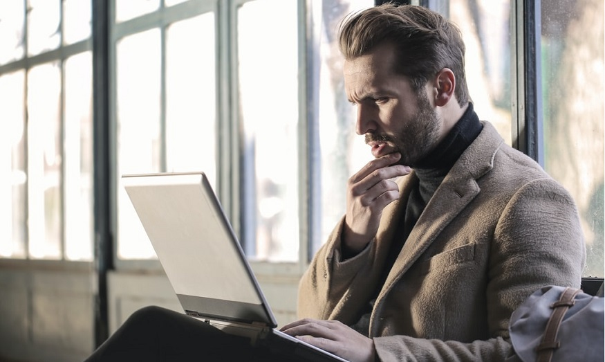 Fiduciary Liability Insurance - man looking at computer in thought