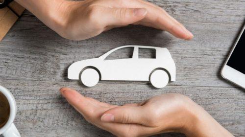 Commercial Auto Insurance - hands surrounding car