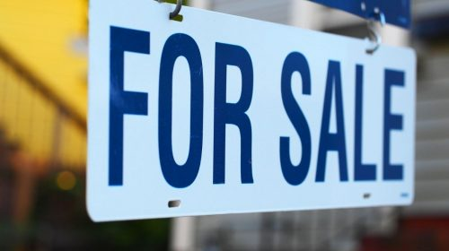 Insurance company - For Sale sign